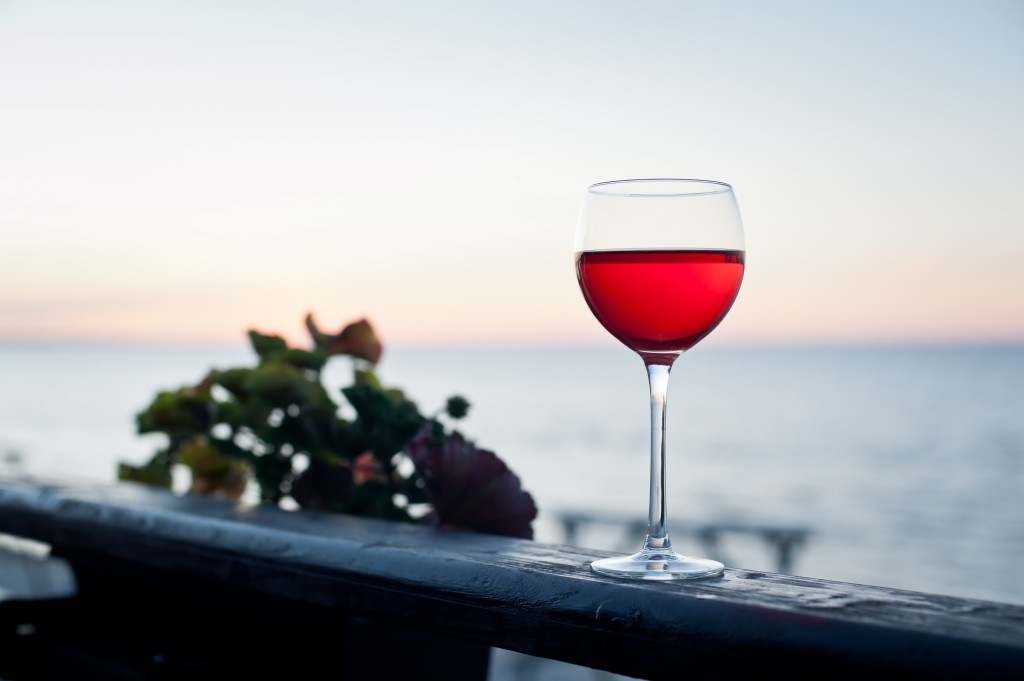 Glass of red wine at sunset on terrace
