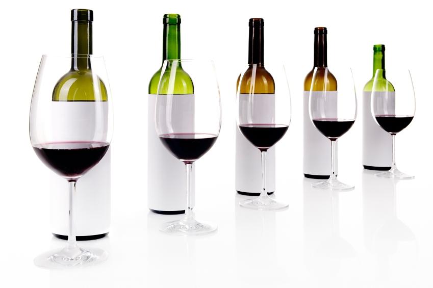 Blind wine tasting on white, masked labels of wine bottles, selective focus