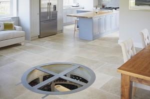 Round hinged glass trap door and Original Spiral Cellar - open plan kitchen 2