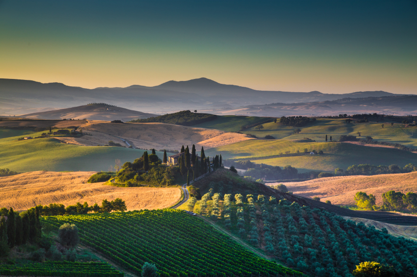 Scenic Tuscany landscape with rolling hills and valleys in golde