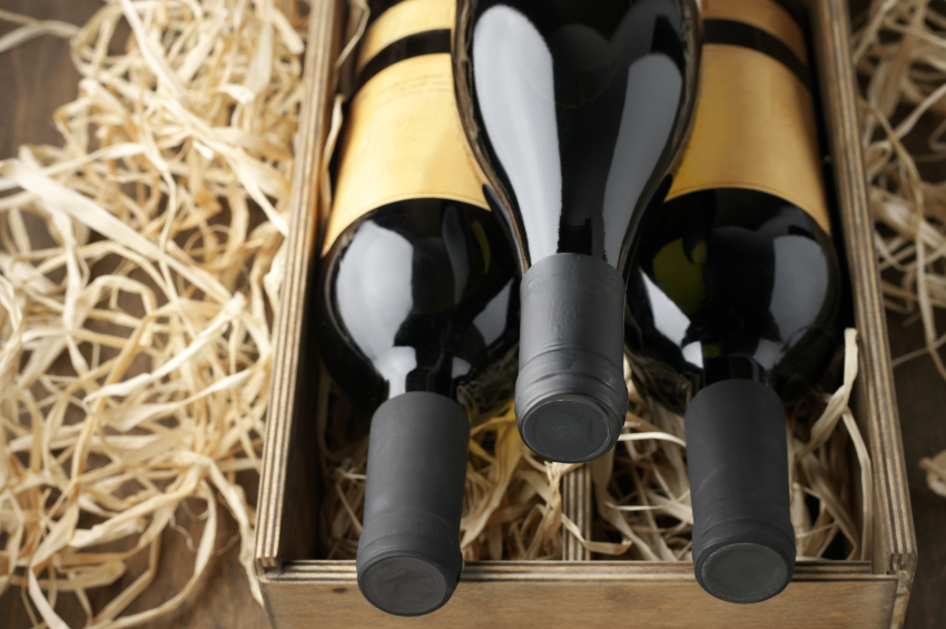 Wine bottles in wooden box and straw