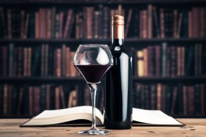 A glass of wine on a table in a library