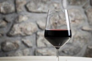 Great red wine glass with restaurant background