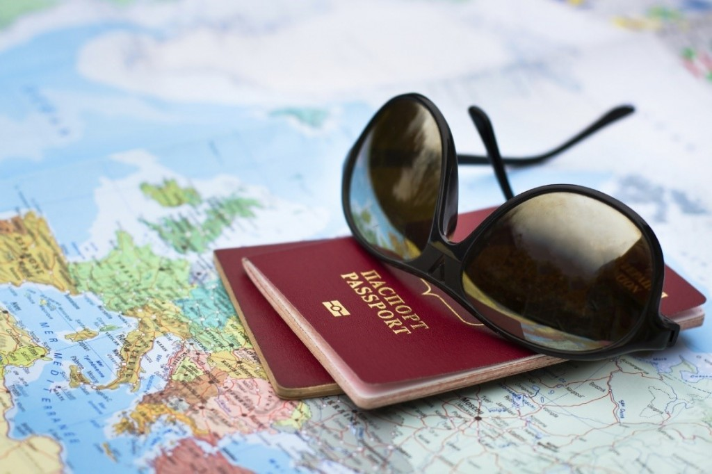 Passports and sunglasses placed on a world map