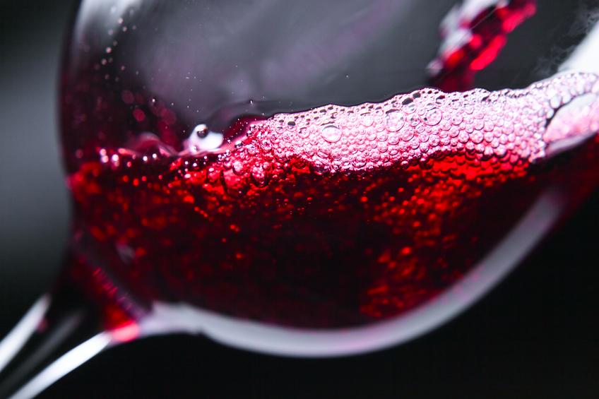 Red wine in wineglass on dark background